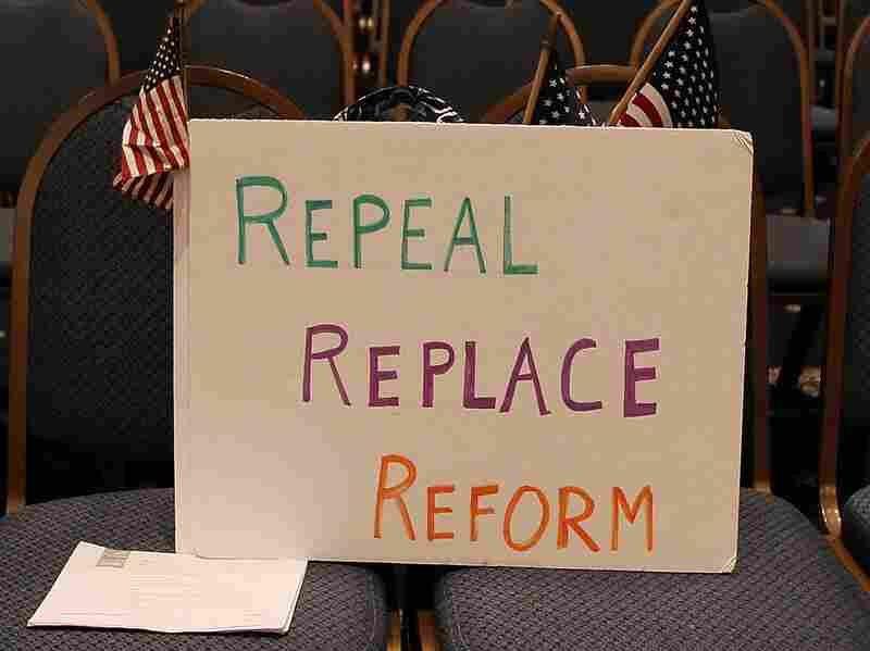 A sign reading 'Repeal Replace Reform' sits on a chair during a news conference at the National Press Club on April 15, 2010 in Washington, D.C. The Obama administration has struggled to sell his health care reform to the public since its passage.