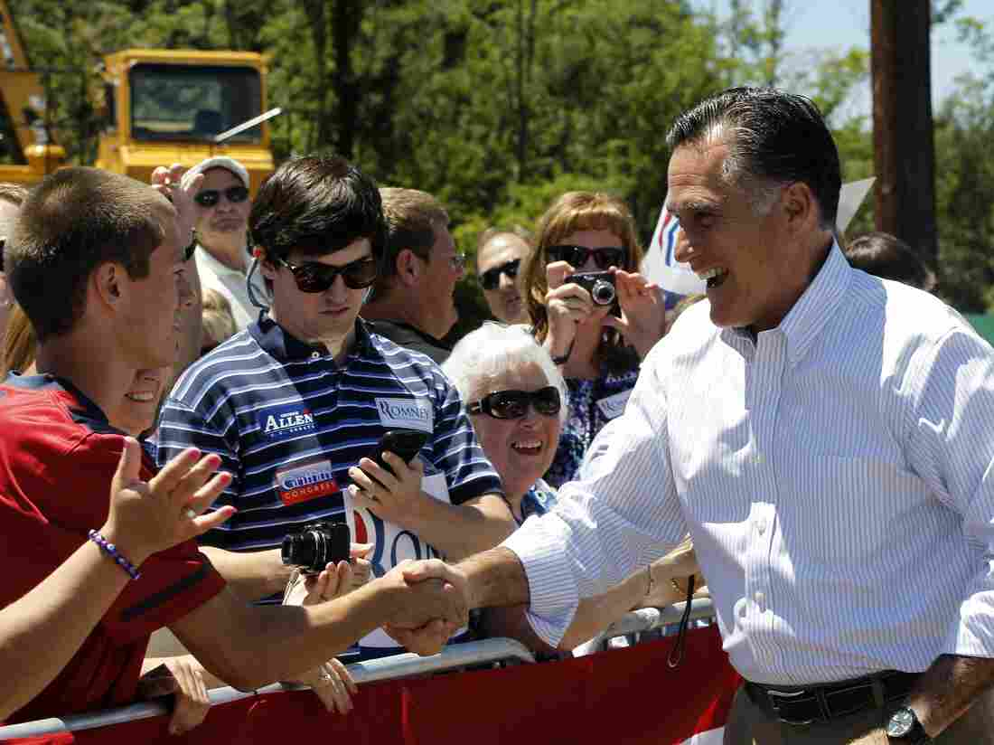 Mitt Romney greeted supporters in Salem, Va., Tuesday, as his campaign tried to frame President Obama as the real outsourcer of U.S. jobs.
