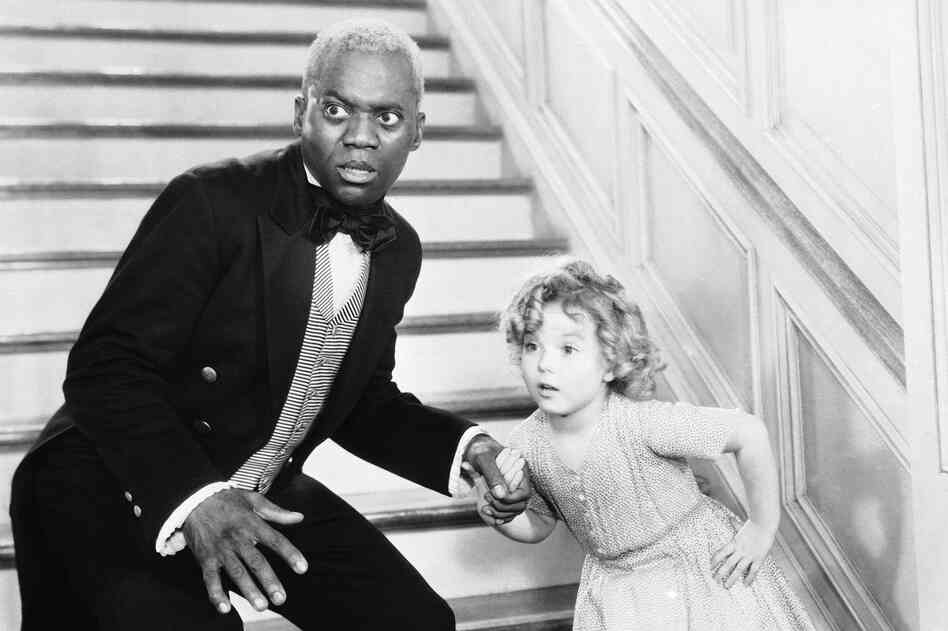 Bill Robinson, as the butler, teaches Shirley Temple his world-famous stair dance in a scene from The Little Colonel in 1935.
