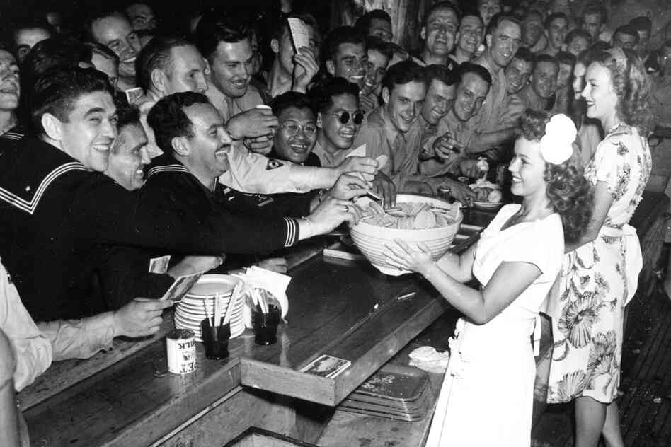 Temple, a USO volunteer, holds a bowl of cookies for servicemen at the Hollywood Canteen in 1944.
