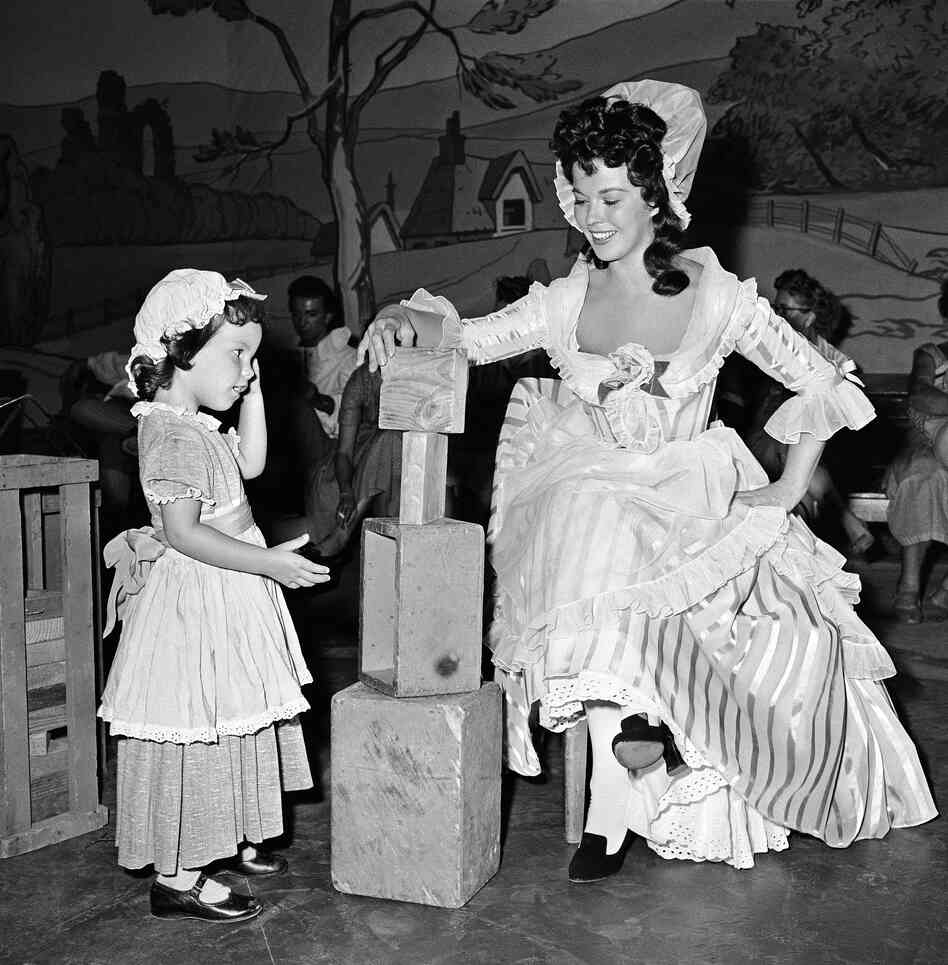 Temple and her daughter Lori prepare for a scene on the television program Shirley Temple's Storybook in 1958.