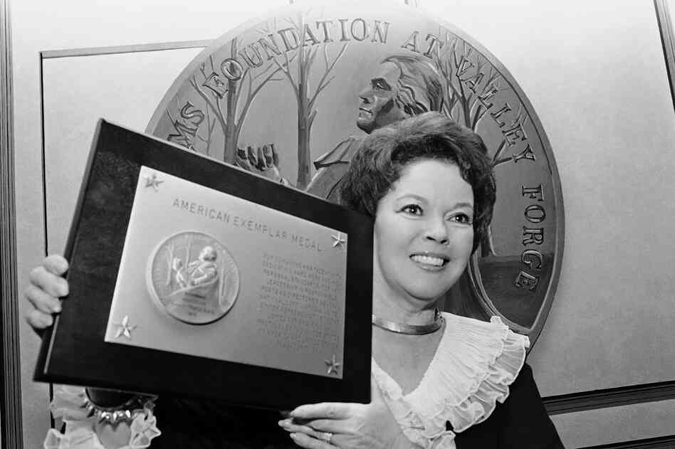Temple receives an award for public service and patriotism presented by the Freedoms Foundation in Philadelphia in 1980.
