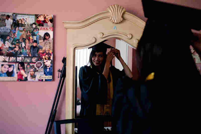 "Ana Venegas, who came to the U.S. from Guadalajara when she was less than a year old, recently graduated from college with a degree in sociology. Because she couldn't get a license, she made a 4-hour round-trip bus commute every day. ""It's been really, really difficult,"" she says."
