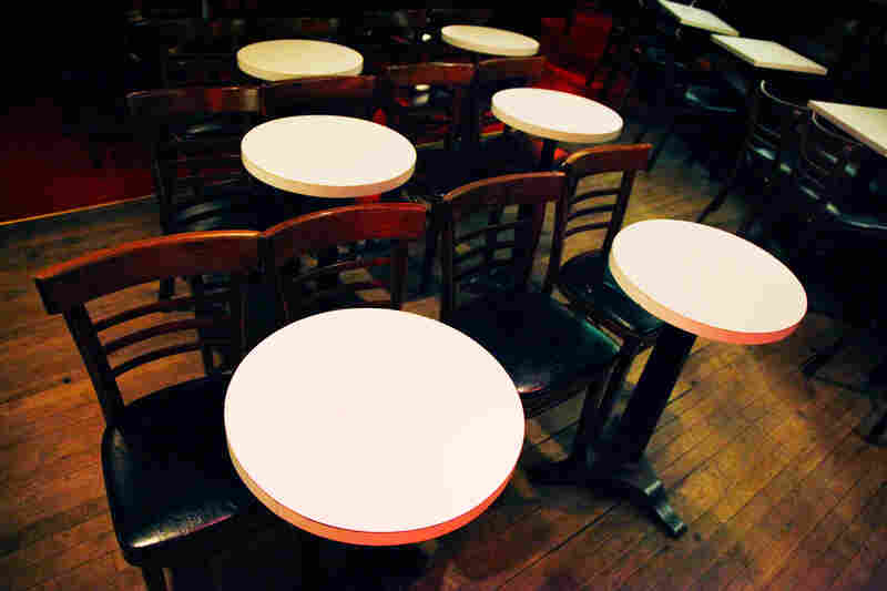 In the interest of accommodating lots of people, tables and chairs should take up as little real estate as humanly possible.