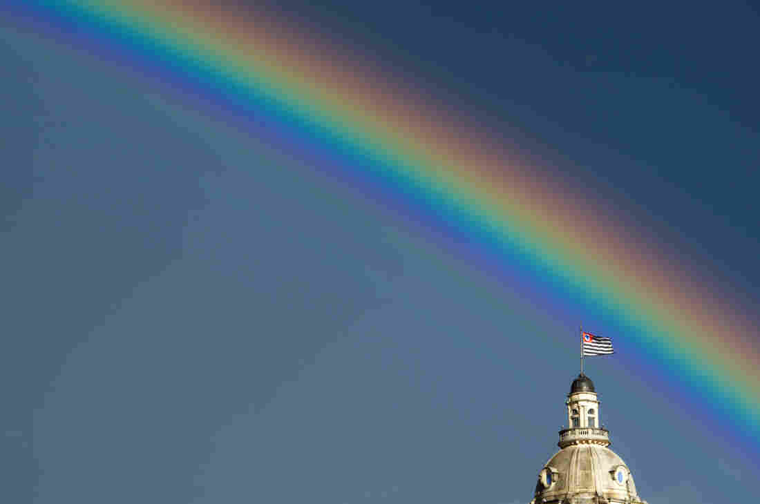 A rainbow over the flag of the Brazilian state of Sao Paulo after the rain on January 14, 2012.