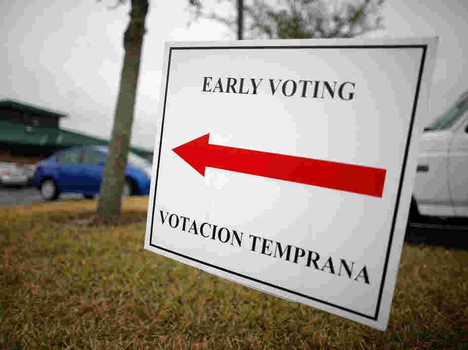 A sign lets voters know they can cast early ballots for the Florida primary election in January at the South Creek Branch Library in Orlando.