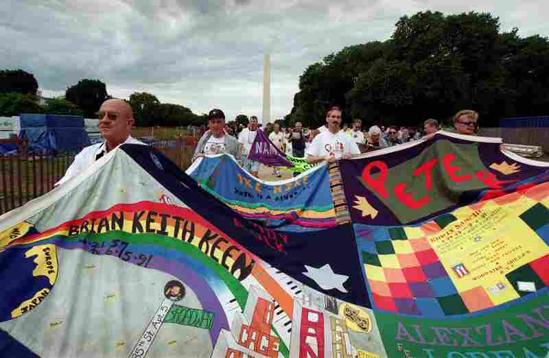 Marchers carry portions of the quilt through the Mall during a 2001 march in observance of the 20th year of public awareness of HIV and AIDS.