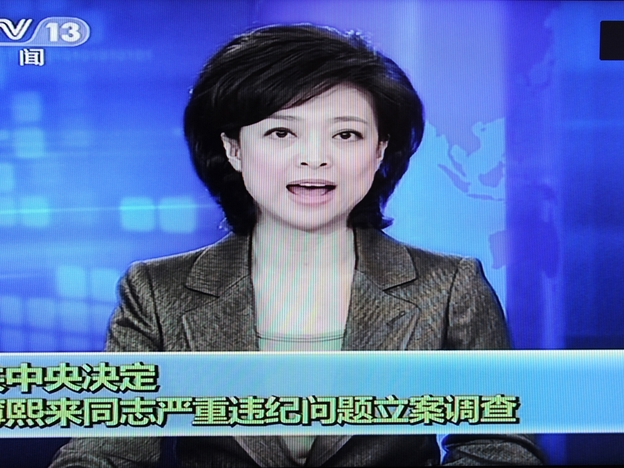 This framegrab taken from China Central Television (CCTV) on April 10 shows a newsreader announcing the suspension of Chinese politician Bo Xilai from the Communist Party's powerful Politburo. Once a rising star, Xilai has been stripped of his post as his wife is investigated for the murder of Neil Heywood, a British national, state media said.