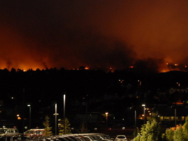 Flames from the Waldo Canyon Fire glowed on the western side of Colorado Springs, Colo., Tuesday night.