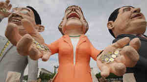 Critics of Germany's spending policy created effigies of Chancellor Angela Merkel (center) and other German leaders to stand near the chancellery in Berlin.