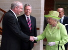 Queen Elizabeth II shook hands with Deputy First Minister of Northern Ireland Martin McGuinness today in Belfast. McGuinness is a former senior member of the IRA.