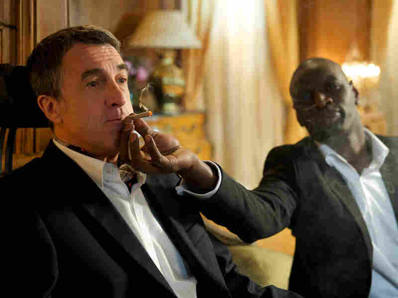 Driss and Philippe (Francois Cluzet) indulge in one of the shared vices that cement their friendship in The Intouchables.