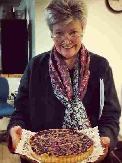 Linda Wertheimer shows off her chess pie with blueberries at the NPR headquarters pie contest.