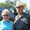 Barbara and Norman Roux stand in front of cattle pens on their farm outside of Moundridge, Kan., where she has raised cattle for nearly 70 years.