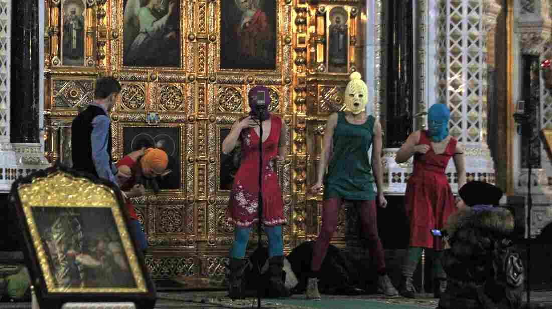 Women in a Russian punk rock group briefly perform a protest song at Moscow's main cathedral, Christ the Savior, in February. The singers criticized the church and Vladimir Putin, who is now president. Three women have been arrested and jailed for months, and the church is demanding harsh punishment.