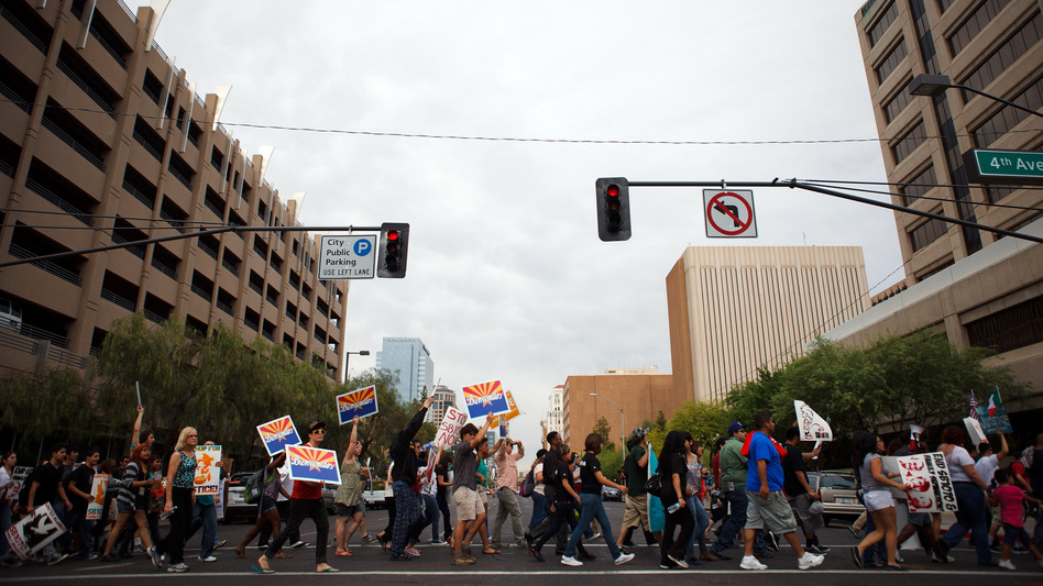 Protesters opposed to Arizona's immigration law march through downtown Phoenix on April 25, the day the U.S. Supreme Court heard arguments over the law.