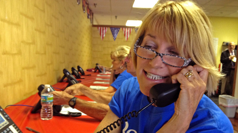 Barbie Snavely works at the Republicans' phone bank in Orange County, Fla. (NPR)