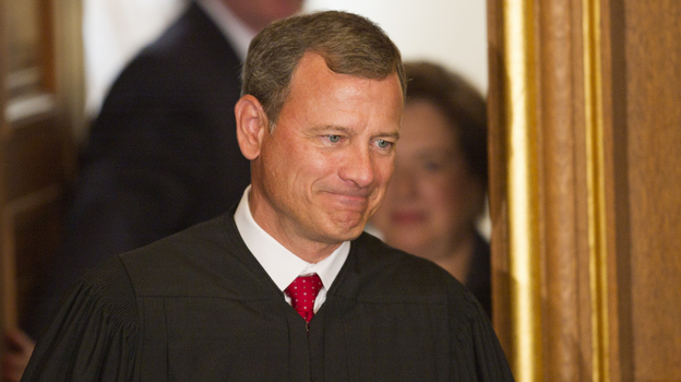 """Chief Justice John Roberts, shown in 2010, is still """"finding his role as chief justice,"""" says one law professor. (AFP/Getty Images)"""