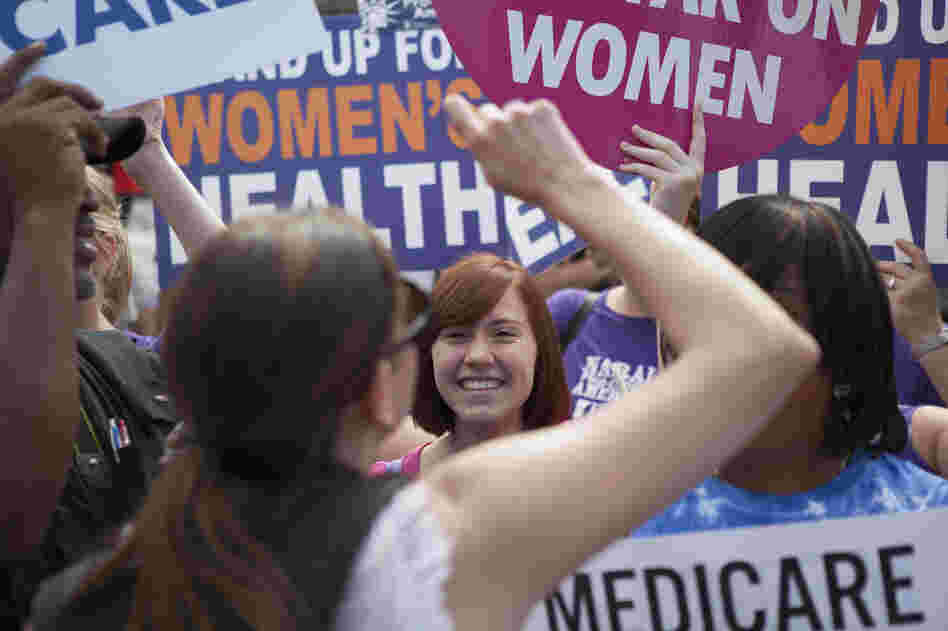 Supporters of President Obama's Affordable Care Act celebrate outside the Supreme Court. Across from the celebration, protesters voiced their opposition to the court's ruling.