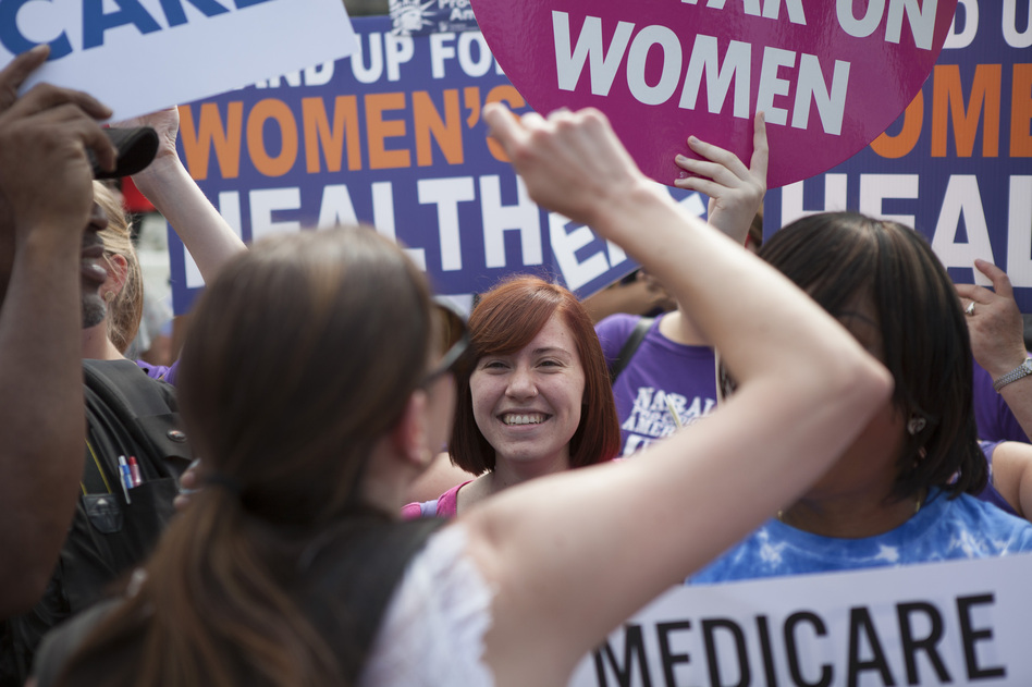 Supporters of President Obama's Affordable Care Act celebrate outside the Supreme Court. Across from the celebration, protesters voiced their opposition to the court's ruling. (NPR)