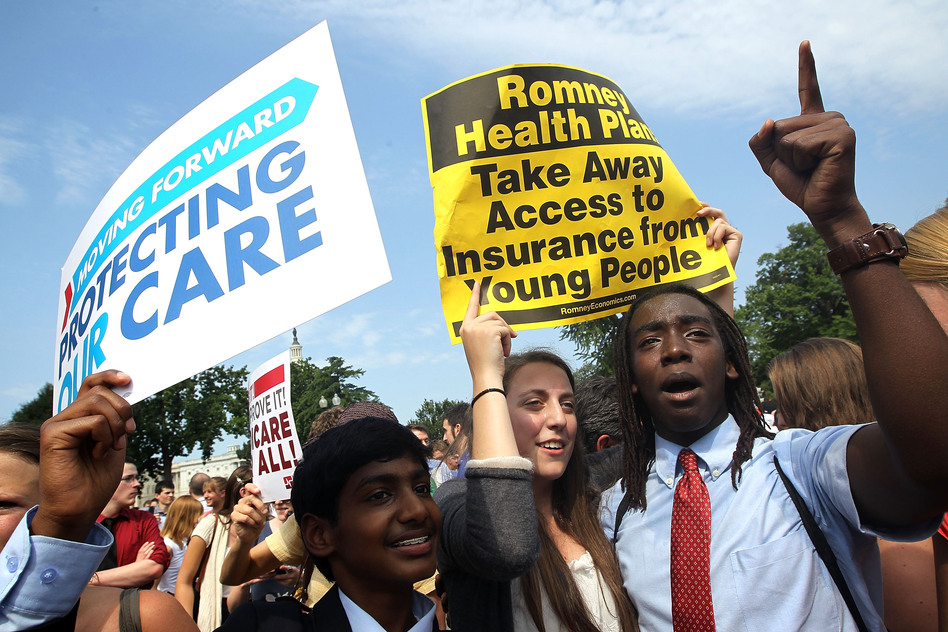 Kailash Sundaran (left), Devyn Greenberg and Devontae Freeland, supporters of President Obama's health care overhaul, cheer outside of the Supreme Court on Thursday, after the court upheld a majority of the law. (Getty Images)