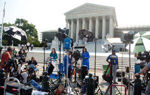 Journalists await the court's decision on the constitutionality of the Affordable Care Act, President Obama's signature legislation.