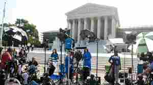 Reporters await a decision by the Supreme Court on the constitutionality of the Affordable Healthcare Act, President Barack Obama's signature healthcare legislation.