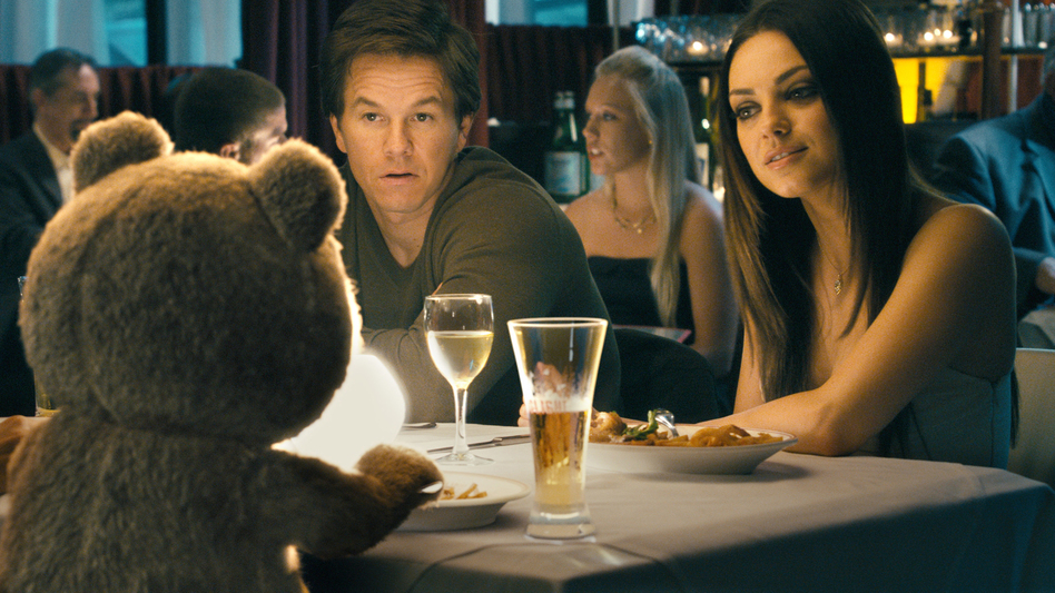 When Johnny's girlfriend, Lori (Mila Kunis), tires of Ted's constant presence around the house, Ted gets a job — which is when the comedy catches fire. (Universal Pictures)