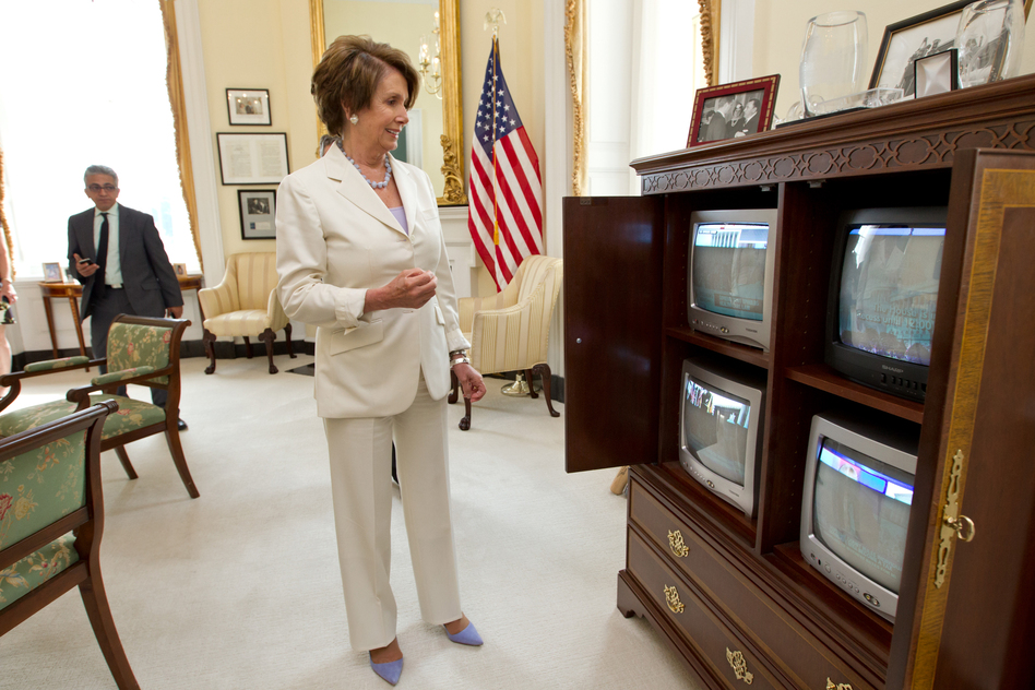 House Minority Leader Nancy Pelosi of California watches the news of the court's ruling unfold on television. Pelosi, the former speaker of the House, was instrumental in helping to pass the health care overhaul in Congress, and was at President Obama's side when he signed it into law. (AP)