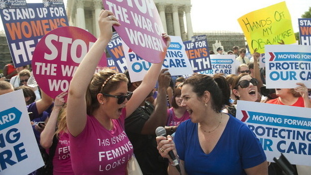 Supporters of President Obama's health care legislation celebrated outside after hearing that the Supreme Court upheld the constitutionality of the Affordable Care Act. (AFP/Getty Images)