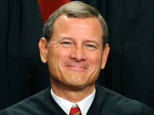 Supreme Court Chief Justice John G. Roberts participates in the court's official photo session on October 8, 2010. Today, the court released its decision on the Affordable Care Act, with Roberts casting the decid