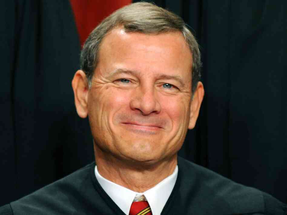 Supreme Court Chief Justice John G. Roberts participates in the court's official photo session on October 8, 2010. Today, the court released its decision on the Affordable Care Act, with Roberts casting the deciding vote to uphold the law.
