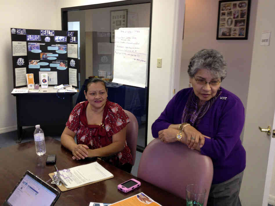 Josephine Mercado (right) with Brenda Serrano at the Hispanic Health Initiatives office in Casselberry, Fla. Mercado says she plans a party now that the Supreme Court has ruled on the health law.
