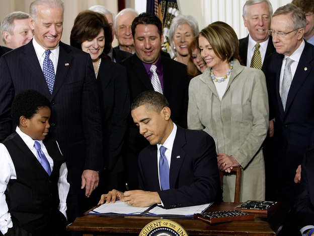 President Obama signs the health care bill into law at the White House on March 23, 2010. (AP)