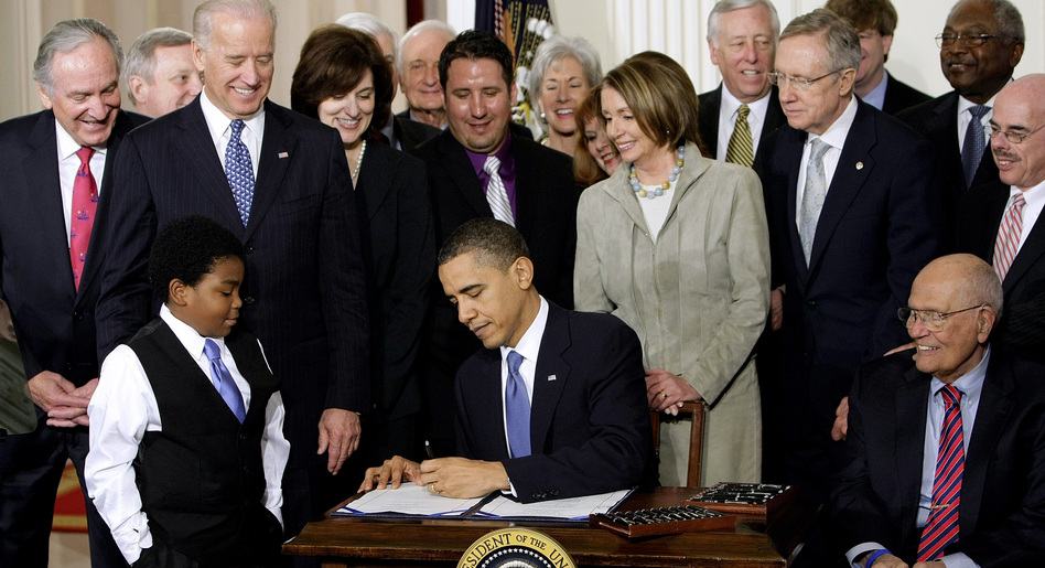 President Obama signs the health care bill into law at the White House on March 23, 2010.