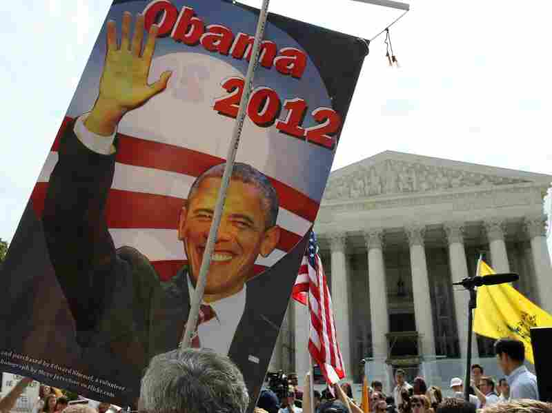 A supporter holds a sign of President Obama in front of the Supreme Court on June 28 in Washington, D.C. Today the high court upheld the  President's health care overhaul, a victory for the president and congressional Democrats.