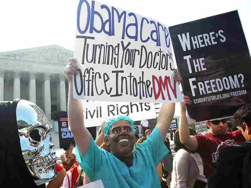 Anti-Obamacare protesters wear masks of President Barack Obama and Grim Reaper as they demonstrate in front of the Supreme Court June 28 in Washington, D.C. The Supreme Court upheld the Affordable Care Act, Obama's landmark health care reforem, this morning.