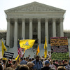 Protesters and supporters of President Obama's health care law await the Supreme Court's ruling Thursday. The court ruled to uphold the law. The focus now shifts to the states, which are responsible for the lion's share of getting people without insurance covered.