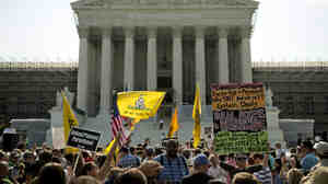 Protesters and supporters of President Obama's health care law await the Supreme Court's ruling Thursday. The