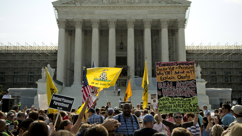 Protesters and supporters of President Obama's health care law await the Supreme Court's ruling Thursday. The court ruled to uphold the law. The focus now shifts to the states, which are responsible for the lion's share of getting people without insurance covered. (UPI /Landov)