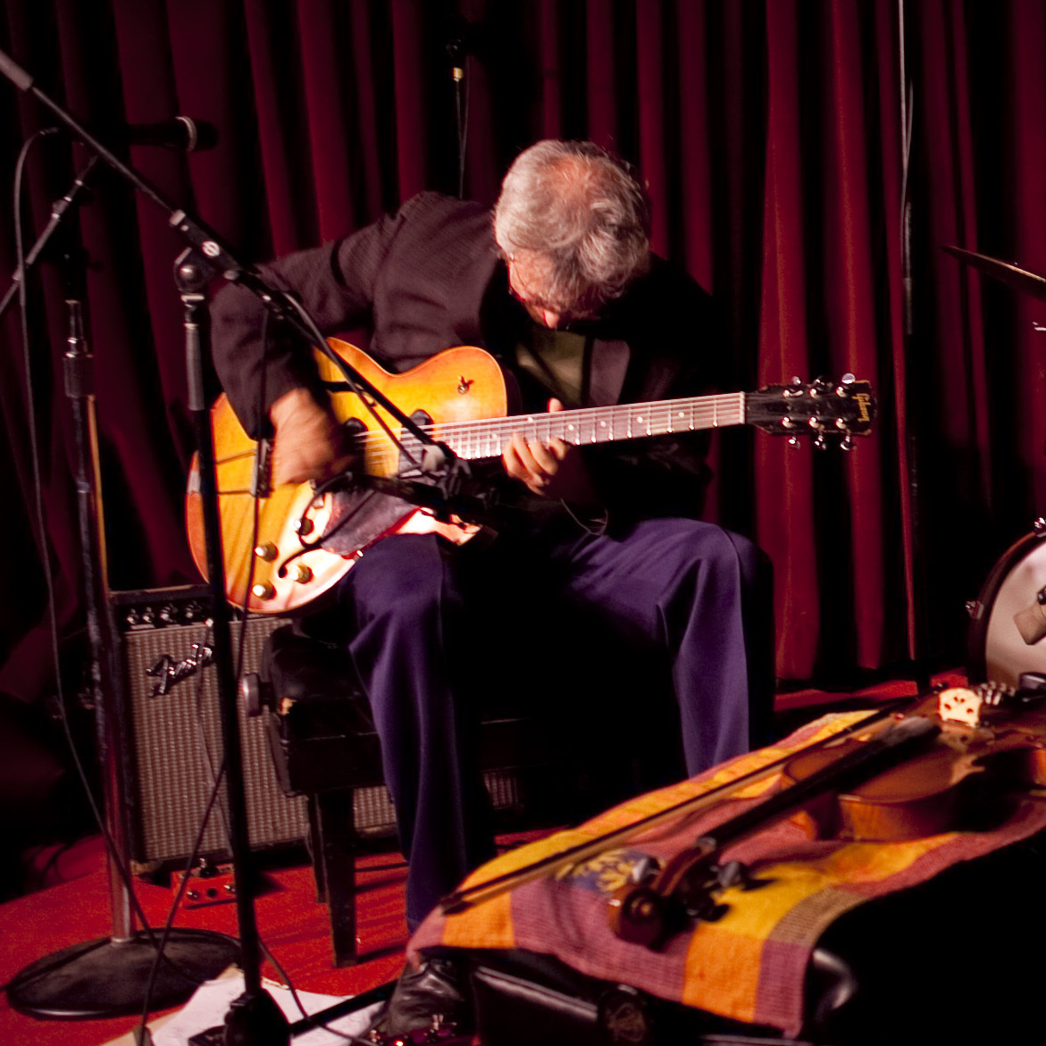 From left, Marc Ribot (guitar), Chad Taylor (drums) and Henry Grimes (bass) performed at the Village Vanguard in New York City on Wednesday, June 27, 2012.