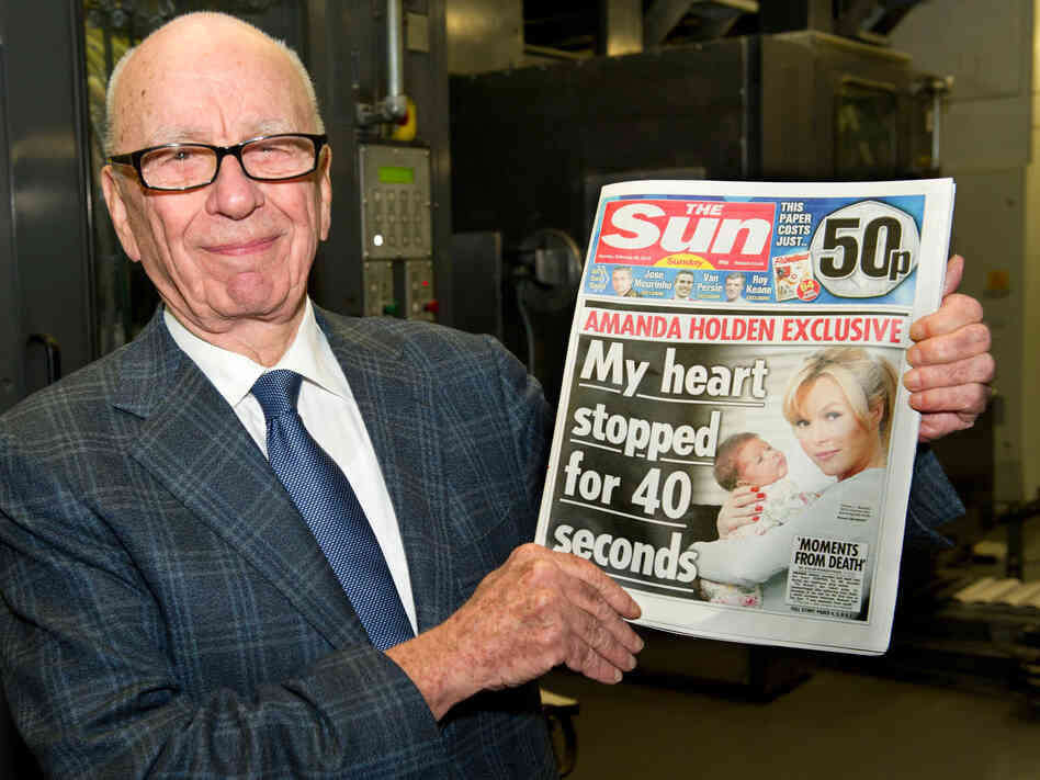 Rupert Murdoch, chairman and CEO of News Corp., with one of his company's British tabloids.
