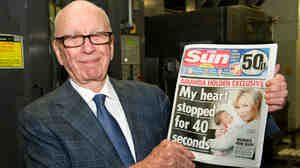 Rupert Murdoch, chairman and CEO of News Corp., with one of his