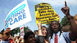 Kailash Sundaran (left), Devyn Greenberg and Devontae Freeland celebrate the Supreme Court's ruling upholding the Affordable Health Care Act outside the court Thursday.