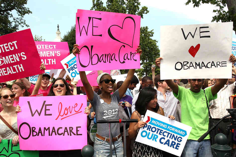 Supporters of President Obama's health care overhaul, cheer outside of the Supreme Court on Thursday, after the court upheld a majority of the law.