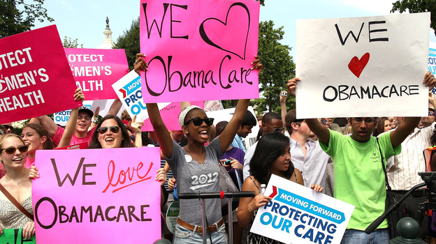 Supporters of President Obama's health care overhaul, cheer outside of the Supreme Court on Thursday, after the court upheld a majority of the law. (Getty Images)