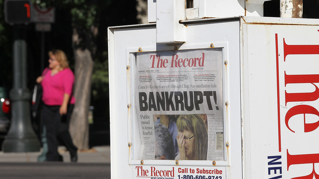 A headline in The Record newspaper in Stockton, Cailf., tells the story of the city's plan for operating under Chapter 9 bankruptcy protection following failed talks with bondholders and labor unions. (Getty Images)