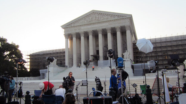 The scene outside the U.S. Supreme Court this morning: lights, camera and soon action.