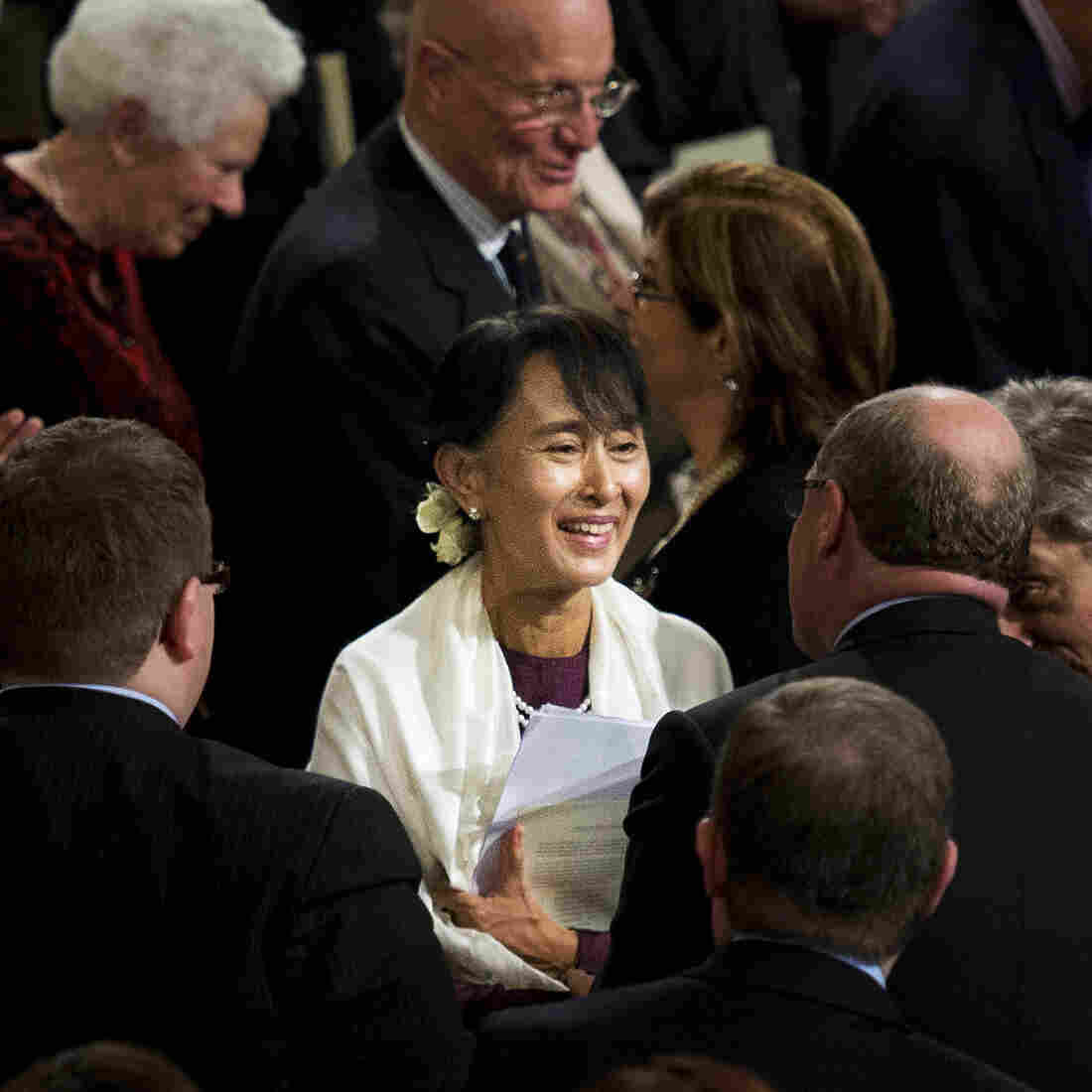 Myanmar opposition leader Aung San Suu Kyi smiles as she leaves Westminster Hall after addressing both Houses of Parliament on June 21 in London.