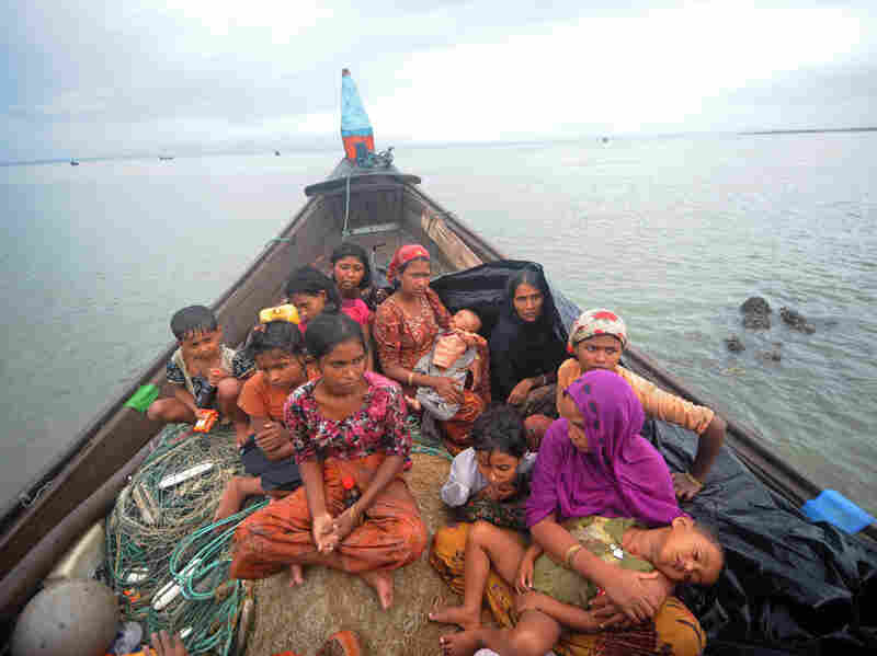 Rohingya Muslims, trying to cross the Naf river into Bangladesh to escape sectarian violence in Myanmar, look on from an intercepted boat in Teknaf, June 13. The plight of the Rohingya minority is one of the tests Suu Kyi faces at home.